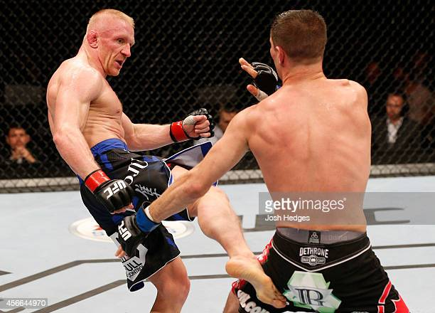Dennis Siver of Germany kicks Charles Rosa in their featherweight bout at the Ericsson Globe Arena on October 4 2014 in Stockholm Sweden