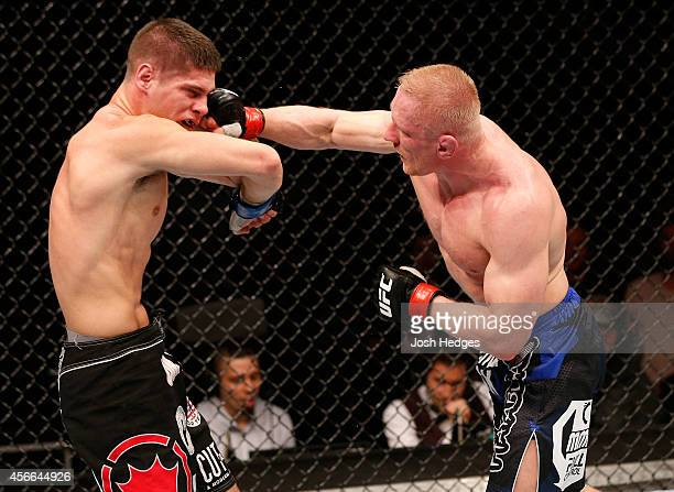 Dennis Siver of Germany punches Charles Rosa in their featherweight bout at the Ericsson Globe Arena on October 4 2014 in Stockholm Sweden
