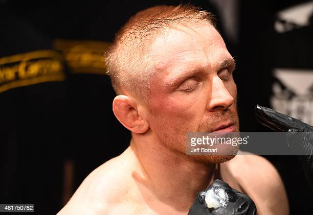Dennis Siver of Germany receives treatment before a featherweight fight against Conor McGregor of Ireland during the UFC Fight Night event at the TD...