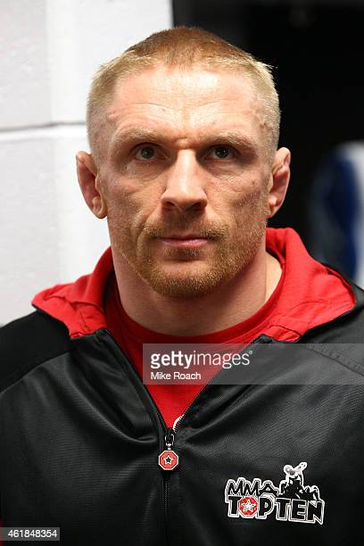 Dennis Siver of Germany warms up backstage before facing Conor McGregor during the UFC Fight Night event at the TD Garden on January 18 2015 in...