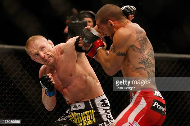 Dennis Siver punches Cub Swanson in their featherweight fight during the UFC 162 event inside the MGM Grand Garden Arena on July 6 2013 in Las Vegas...