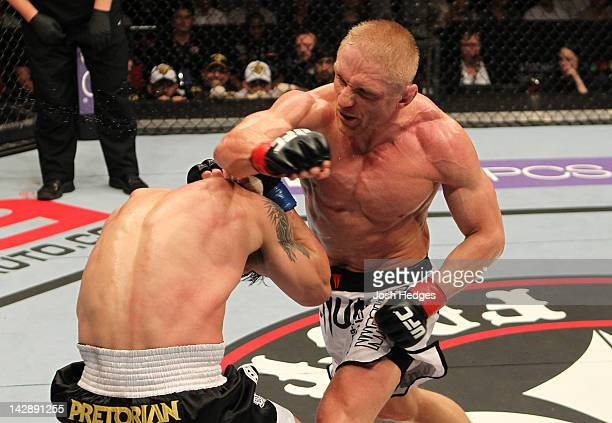 Dennis Siver punches Diego Nunes during their featherweight bout at the UFC on Fuel TV event at Ericsson Globe on April 14 2012 in Stockholm Sweden