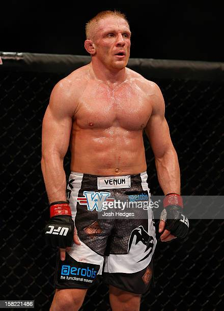 Dennis Siver stands in the Octagon between rounds during his featherweight bout against Nam Phan at the UFC on FOX event on December 8 2012 at Key...