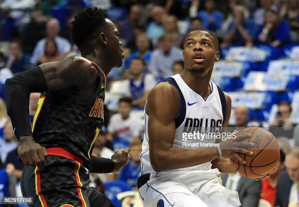 Dennis Smith Jr #1 of the Dallas Mavericks dribbles the ball against Dennis Schroder of the Atlanta Hawks in the first half at American Airlines...
