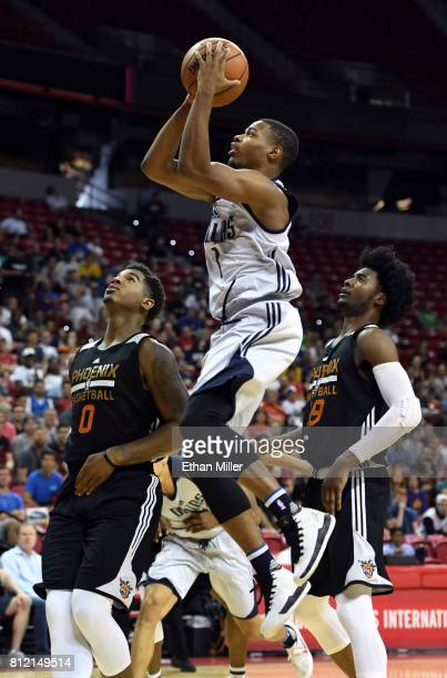 Dennis Smith Jr #1 of the Dallas Mavericks drives to the basket between Marquese Chriss and Josh Jackson of the Phoenix Suns during the 2017 Summer...