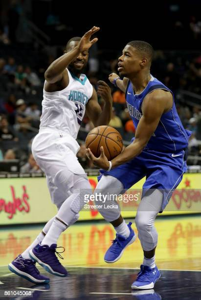 Dennis Smith Jr #1 of the Dallas Mavericks drives to the basket against Kemba Walker of the Charlotte Hornets during their game at Spectrum Center on...