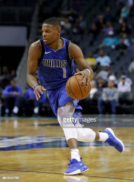 Dennis Smith Jr #1 of the Dallas Mavericks drives to the basket against the Charlotte Hornets during their game at Spectrum Center on October 13 2017...