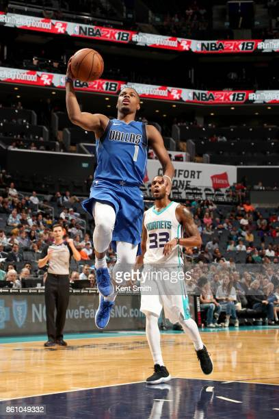 Dennis Smith Jr #1 of the Dallas Mavericks goes to the basket against the Charlotte Hornets on October 13 2017 at Spectrum Center in Charlotte North...