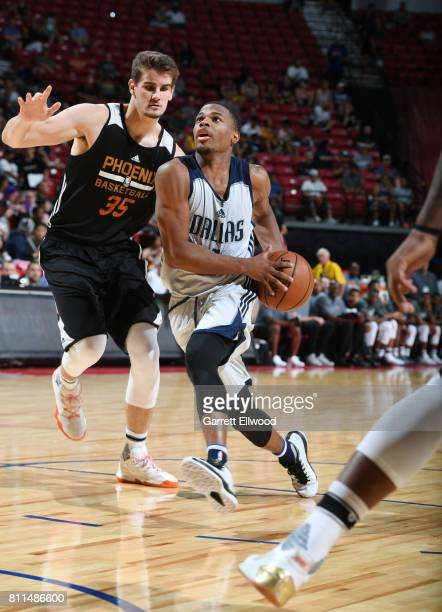 Dennis Smith Jr #1 of the Dallas Mavericks handles the ball against Dragan Bender of the Phoenix Suns during the 2017 Summer League on July 9 2017 at...
