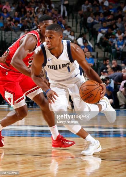 Dennis Smith Jr #1 of the Dallas Mavericks handles the ball against the Chicago Bulls during the preseason game on October 4 2017 at the American...
