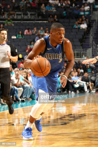 Dennis Smith Jr #1 of the Dallas Mavericks handles the ball against the Charlotte Hornets on October 13 2017 at Spectrum Center in Charlotte North...