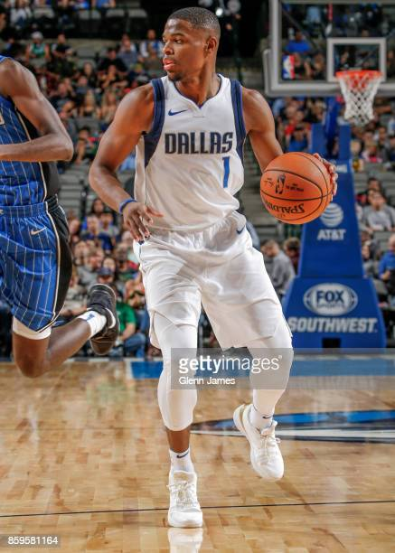 Dennis Smith Jr #1 of the Dallas Mavericks handles the ball during a preseason game against the Orlando Magic on October 9 2017 at the American...