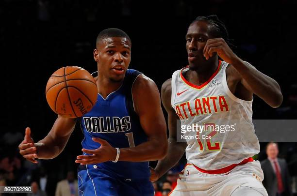 Dennis Smith Jr #1 of the Dallas Mavericks loses the ball as he drives against Taurean Prince of the Atlanta Hawks at McCamish Pavilion on October 12...