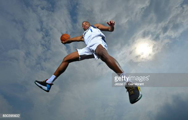 Dennis Smith Jr #1 of the Dallas Mavericks poses for a portrait during the 2017 NBA rookie photo shoot on August 11 2017 at the Madison Square Garden...