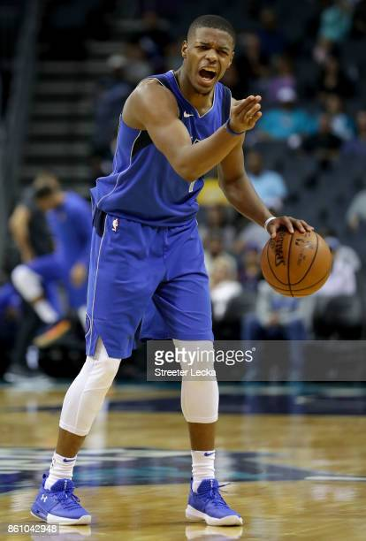 Dennis Smith Jr #1 of the Dallas Mavericks reacts against the Charlotte Hornets during their game at Spectrum Center on October 13 2017 in Charlotte...