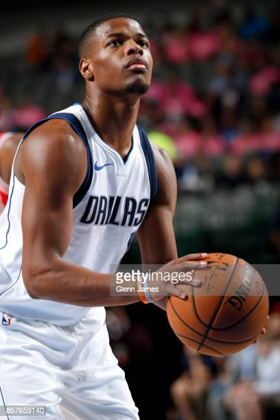 Dennis Smith Jr #1 of the Dallas Mavericks shoots a free throw against the Chicago Bulls on October 4 2017 at the American Airlines Center in Dallas...