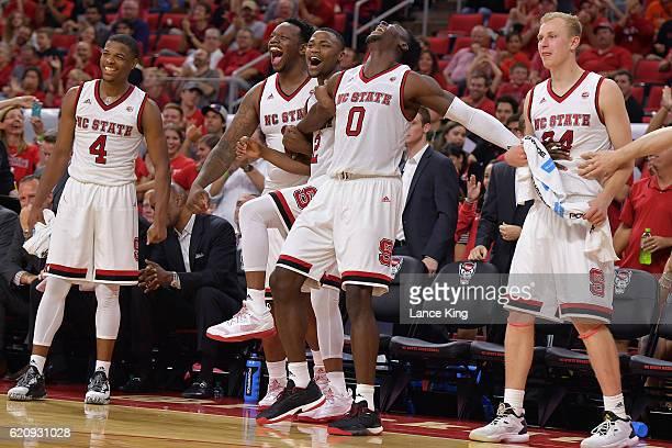 Dennis Smith Jr #4 BeeJay Anya Torin Dorn AbdulMalik Abu and Maverick Rowan of the North Carolina State Wolfpack react from their bench during their...