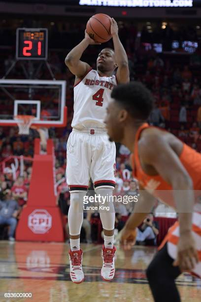 Dennis Smith Jr #4 of the North Carolina State Wolfpack puts up a shot against the Syracuse Orange at PNC Arena on February 1 2017 in Raleigh North...