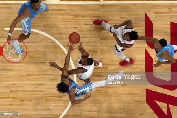Dennis Smith Jr #4 of the North Carolina State Wolfpack puts up a shot against Joel Berry II of the North Carolina Tar Heels at PNC Arena on February...