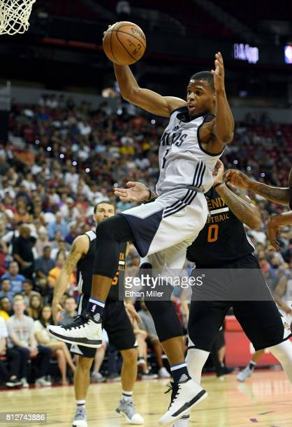 Dennis Smith Jr of the Dallas Mavericks grabs a rebound against the Phoenix Suns during the 2017 Summer League at the Thomas Mack Center on July 9...