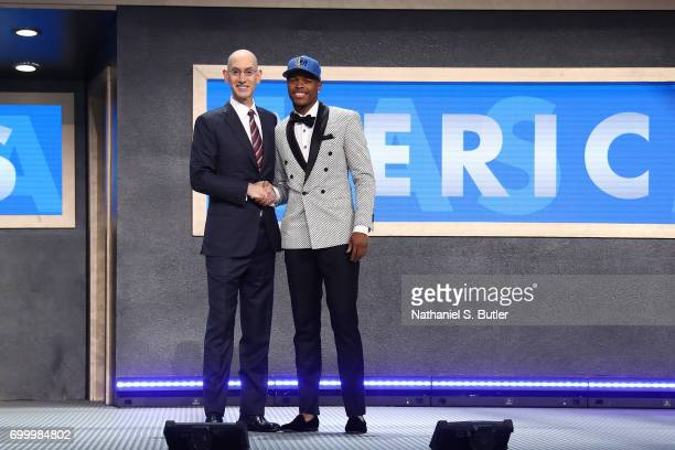Dennis Smith Jr shakes hands with NBA Commissioner Adam Silver after being selected number nine overall by the Dallas Mavericks during the 2017 NBA...