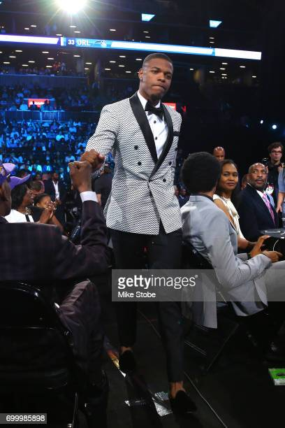 Dennis Smith Jr walks to the stage after being drafted ninth overall by the Dallas Mavericks during the first round of the 2017 NBA Draft at Barclays...