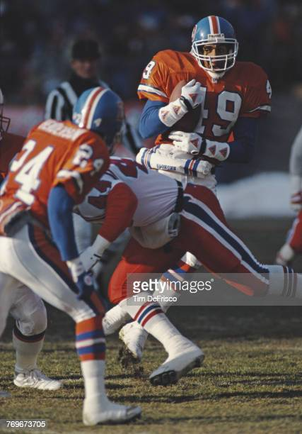 Dennis Smith Strong Safety for the Denver Broncos runs the ball during the American Football Conference West game against the New England Patriots on...