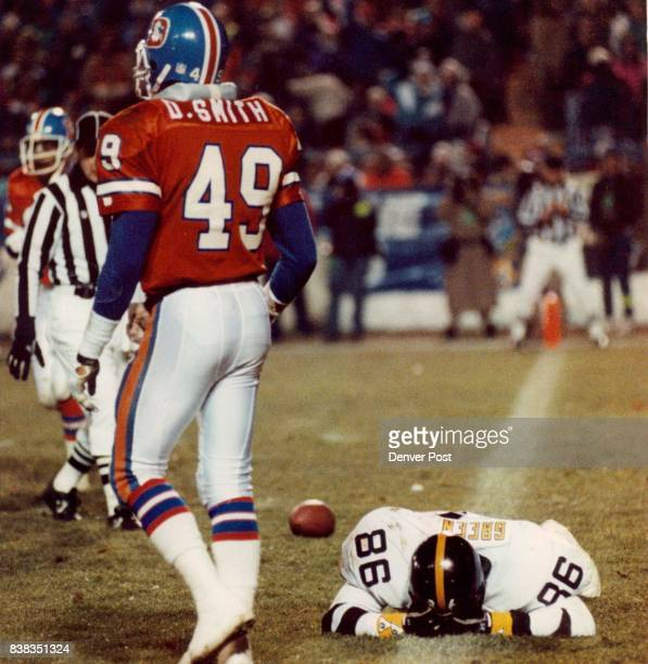 Dennis Smith walks away from a dejected Eric Green as he buried his face in the turf after missing the potential game typing TD in the winding...