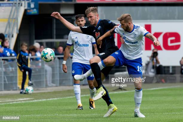 Dennis Srbeny of Paderborn and Guido Burgstaller of Schalke battle for the ball during the preseason friendly match between SC Paderborn and FC...
