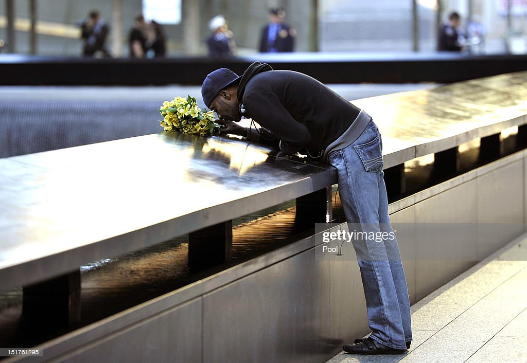 Dennis Swindell kisses the name of his partner Gary Lee Bright inscribed on the South Tower memorial pool wall during observances for the eleventh anniversary of the terrorist attacks on lower Manhattan at the World Trade Center site September 11, 2012 in New York City. The nation is commemorating the eleventh anniversary of the September 11, 2001 attacks which resulted in the deaths of nearly 3,000 people after two hijacked planes crashed into the World Trade Center, one into the Pentagon in Arlington, Virginia and one crash landed in Shanksville, Pennsylvania.