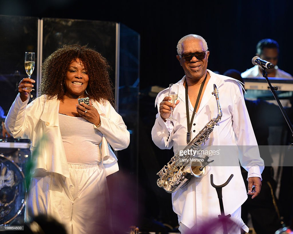 Dennis Thomas and his wife celebrate on stage as Kool & The Gang perform at Seminole Casino Coconut Creek on December 31, 2012 in Coconut Creek, Florida.