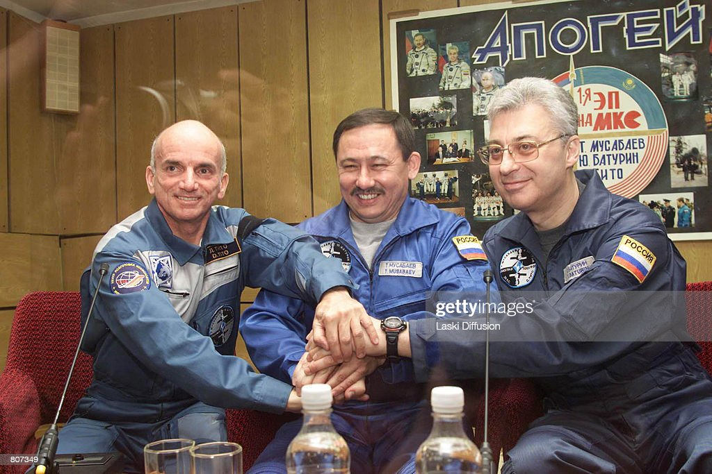 Dennis Tito, left, the world's first space tourist, poses with Russian cosmonauts Talgat Musabayev and Yuri Baturin, April 27, 2001 at the Baikonur cosmodrome in Kazakhstan. Tito was scheduled to lift off into space on April 28, 2001 on a six-day journey to the International Space Station.