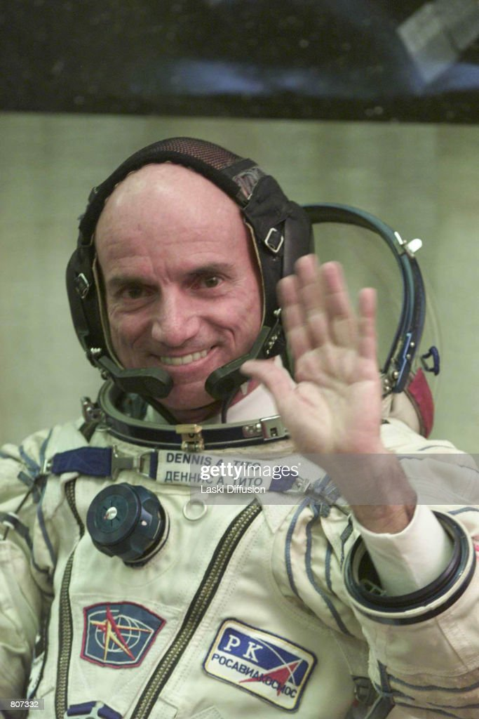 Dennis Tito, the world's first space tourist, waves before boarding the Soyuz TM-32 spaceship April 28, 2001 at the Baikonur cosmodrome in Kazakhstan. Tito is paying the Russian space agency $20 million for the six-day journey to the International Space Station.