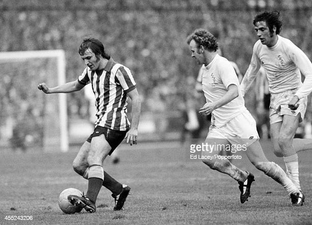 Dennis Tueart of Sunderland is chased by Billy Bremner and Norman Hunter of Leeds United during the FA Cup Final at Wembley Stadium in London on 5th...