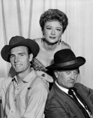 Dennis Weaver as Chester Goode Amanda Blake as Kitty Russell and Milburn Stone as Doc Adams and in GUNSMOKE Image dated May 27 1960