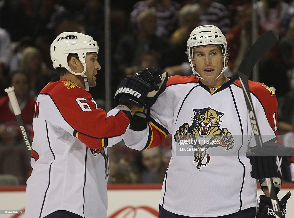 Dennis Wideman and David Booth of the Florida Panthers celebrate Booth's first period goal against the Montreal Canadiens at the Bell Centre on...