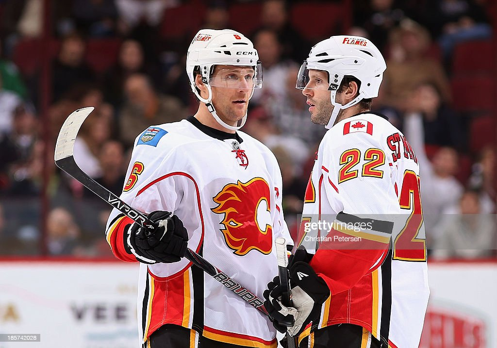 Dennis Wideman #6 and Lee Stempniak #22 of the Calgary Flames talk during the NHL game against the Phoenix Coyotes at Jobing.com Arena on October 22, 2013 in Glendale, Arizona. The Coyotes defeated the Flames 4-2.