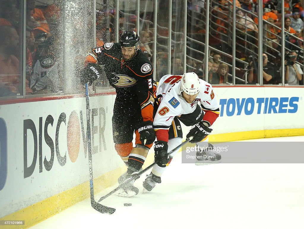 Dennis Wideman #6 of the Calgary Flames and Clayton Stoner #3 of the Anaheim Ducks battle for the puck in Game Two of the Western Conference Semifinals during the 2015 NHL Stanley Cup Playoffs at Honda Center on May 3, 2015 in Anaheim, California.