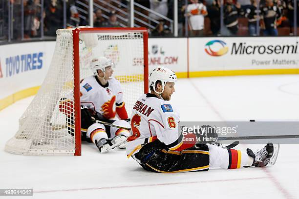 Dennis Wideman of the Calgary Flames and Joe Colborne of the Calgary Flames react to an empty net goal by Ryan Kesler of the Anaheim Ducks during the...