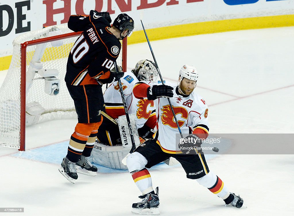 Dennis Wideman #6 of the Calgary Flames attempts to block the puck as it sails towards goalie Karri Ramo #31 before Corey Perry #10 of the Anaheim Ducks tucked it for the game-winning goal in overtime in Game Five of the Western Conference Semifinals during the 2015 Stanley Cup Playoffs at Honda Center on May 10, 2015 in Anaheim, California. Ducks eliminated the Flames, 3-2, in overtime.