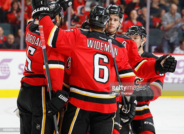 Dennis Wideman of the Calgary Flames celebrates with teammates after a goal against the Detroit Red Wings at Scotiabank Saddledome on October 23 2015...