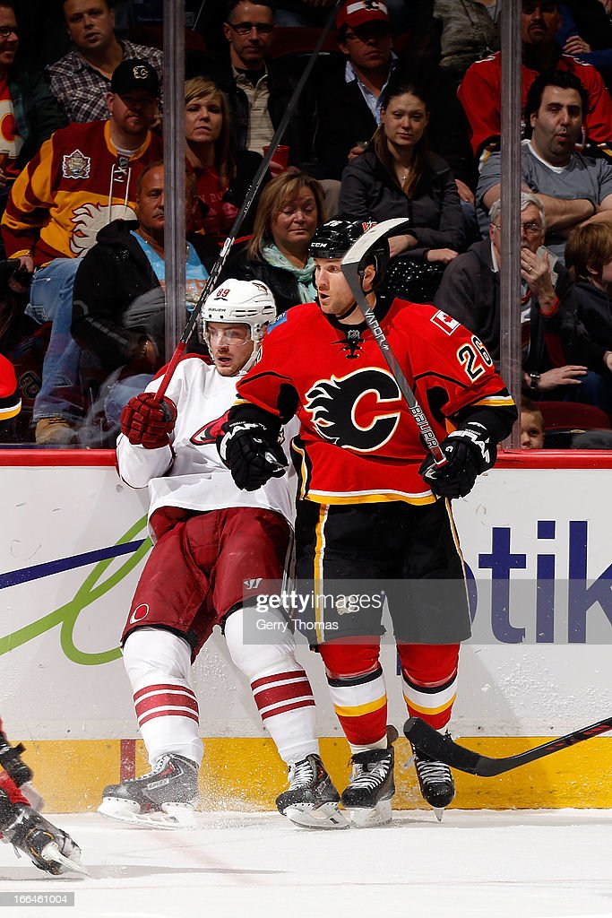 <a gi-track='captionPersonalityLinkClicked' href=/galleries/search?phrase=Dennis+Wideman&family=editorial&specificpeople=575234 ng-click='$event.stopPropagation()'>Dennis Wideman</a> #26 of the Calgary Flames checks <a gi-track='captionPersonalityLinkClicked' href=/galleries/search?phrase=Mikkel+Boedker&family=editorial&specificpeople=4697252 ng-click='$event.stopPropagation()'>Mikkel Boedker</a> #89 of the Phoenix Coyotes on April 12, 2013 at the Scotiabank Saddledome in Calgary, Alberta, Canada.
