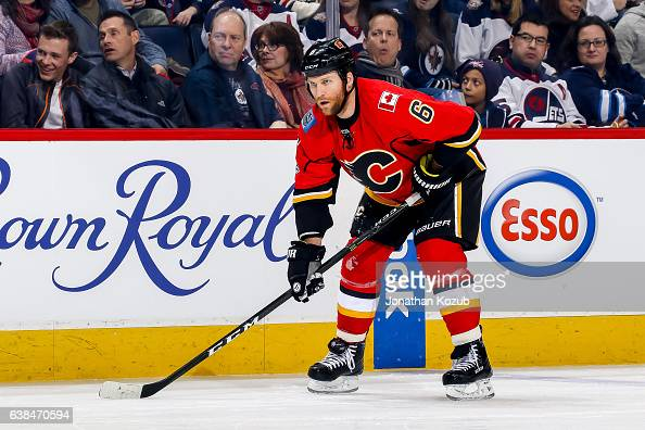 Dennis Wideman of the Calgary Flames gets set for a first period faceoff against the Winnipeg Jets at the MTS Centre on January 9 2017 in Winnipeg...