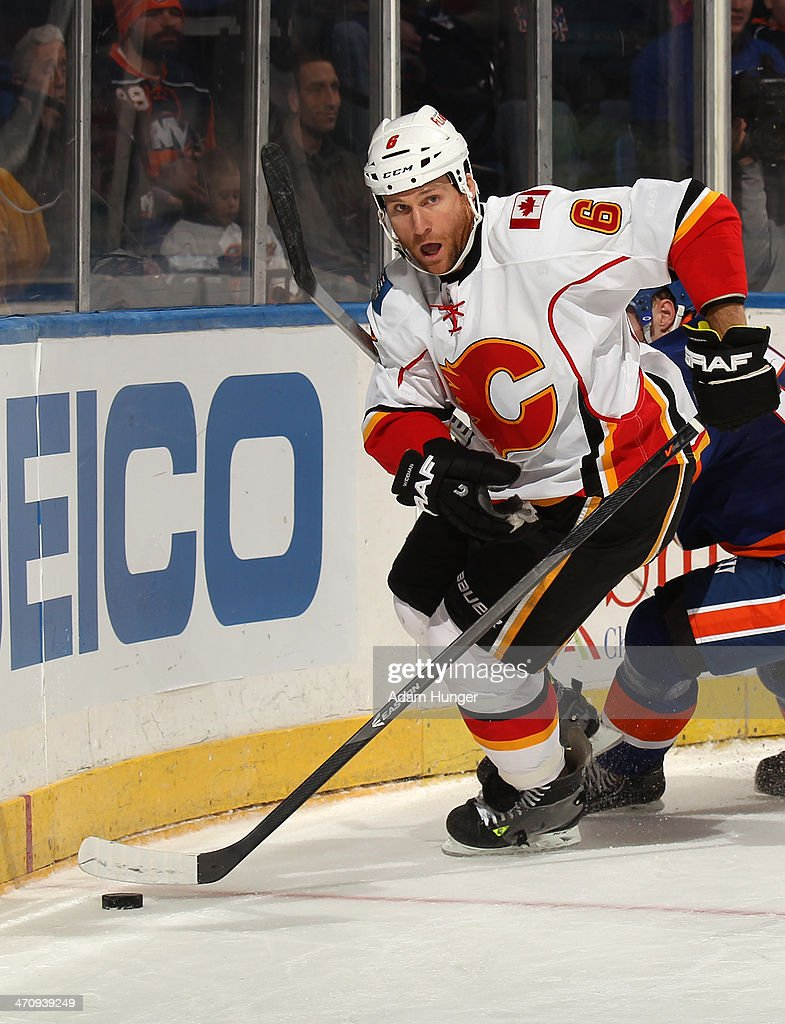 Dennis Wideman #6 of the Calgary Flames in action against the New York Islanders at Nassau Coliseum on February 6, 2014 in Uniondale, New York.