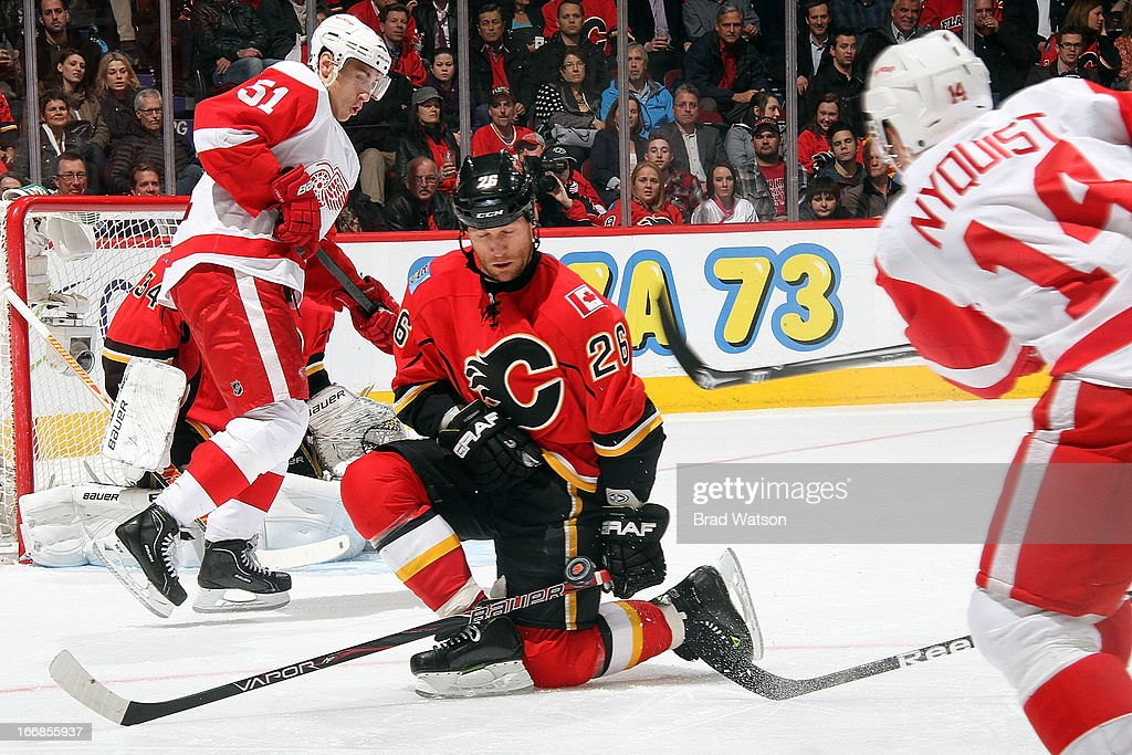 <a gi-track='captionPersonalityLinkClicked' href=/galleries/search?phrase=Dennis+Wideman&family=editorial&specificpeople=575234 ng-click='$event.stopPropagation()'>Dennis Wideman</a> #26 of the Calgary Flames kneels to block a shot from Gustav Nyquist #14 of the Detroit Red Wings on April 17, 2013 at the Scotiabank Saddledome in Calgary, Alberta, Canada.