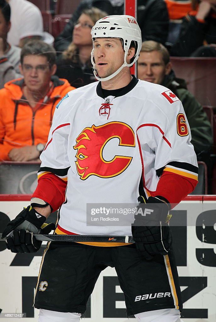 Dennis Wideman #6 of the Calgary Flames looks on against the Philadelphia Flyers on February 8, 2014 at the Wells Fargo Center in Philadelphia, Pennsylvania.