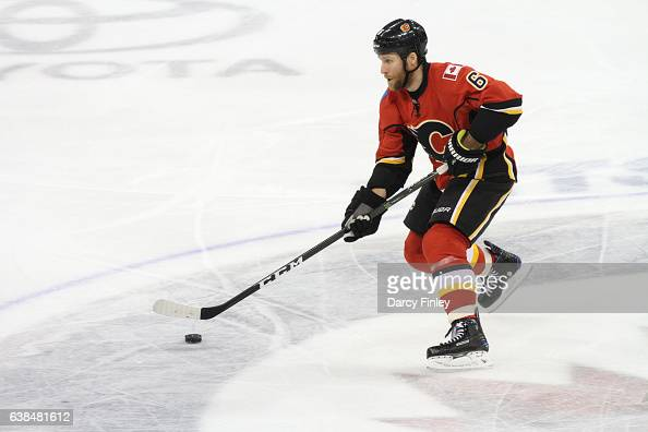 Dennis Wideman of the Calgary Flames plays the puck down the ice during second period action against the Winnipeg Jets at the MTS Centre on January 9...