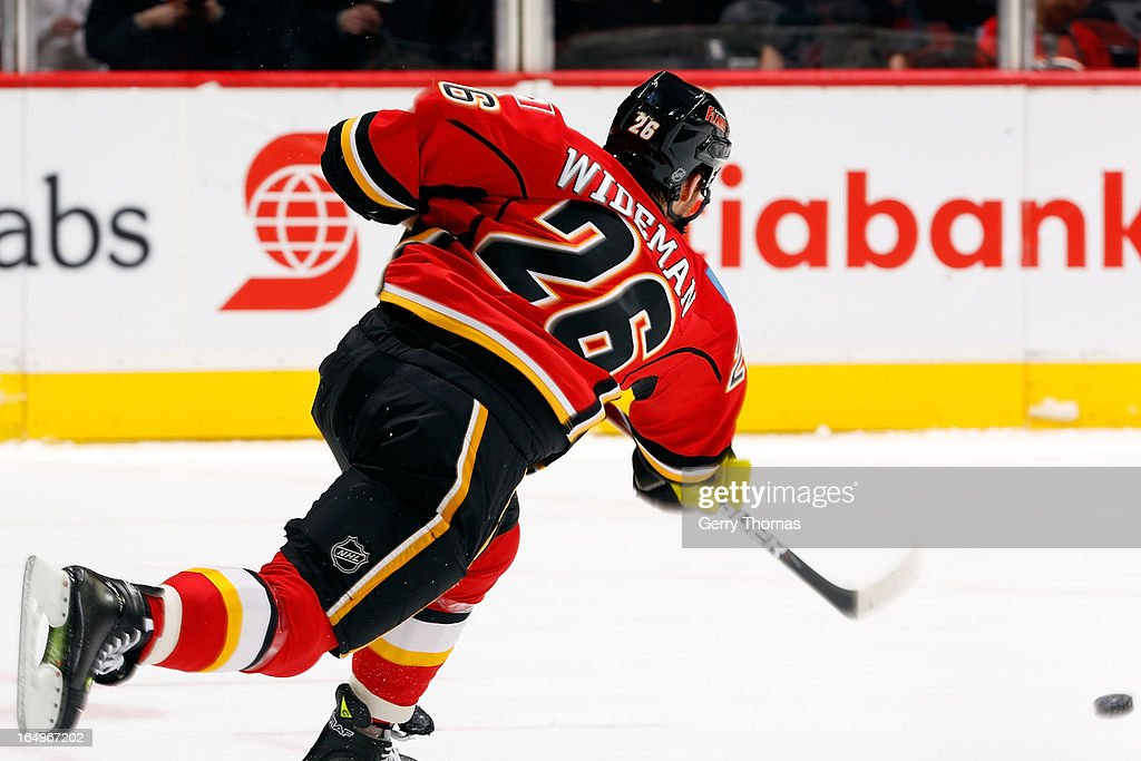 <a gi-track='captionPersonalityLinkClicked' href=/galleries/search?phrase=Dennis+Wideman&family=editorial&specificpeople=575234 ng-click='$event.stopPropagation()'>Dennis Wideman</a> #26 of the Calgary Flames shoots the puck against the Columbus Blue Jackets on March 29, 2013 at the Scotiabank Saddledome in Calgary, Alberta, Canada.
