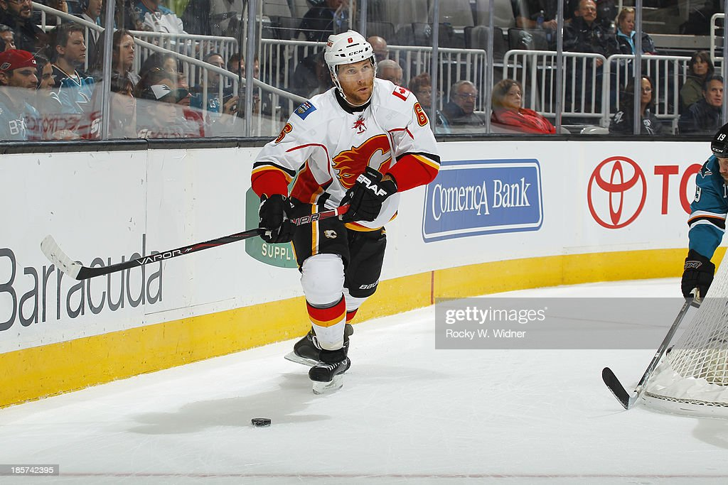 Dennis Wideman #6 of the Calgary Flames skates after the puck against San Jose Sharks at SAP Center on October 19 2013 in San Jose, California.