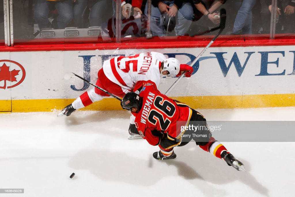 <a gi-track='captionPersonalityLinkClicked' href=/galleries/search?phrase=Dennis+Wideman&family=editorial&specificpeople=575234 ng-click='$event.stopPropagation()'>Dennis Wideman</a> #26 of the Calgary Flames skates against <a gi-track='captionPersonalityLinkClicked' href=/galleries/search?phrase=Cory+Emmerton&family=editorial&specificpeople=570505 ng-click='$event.stopPropagation()'>Cory Emmerton</a> #25 of the Detroit Red Wings on March 13, 2013 at the Scotiabank Saddledome in Calgary, Alberta, Canada.
